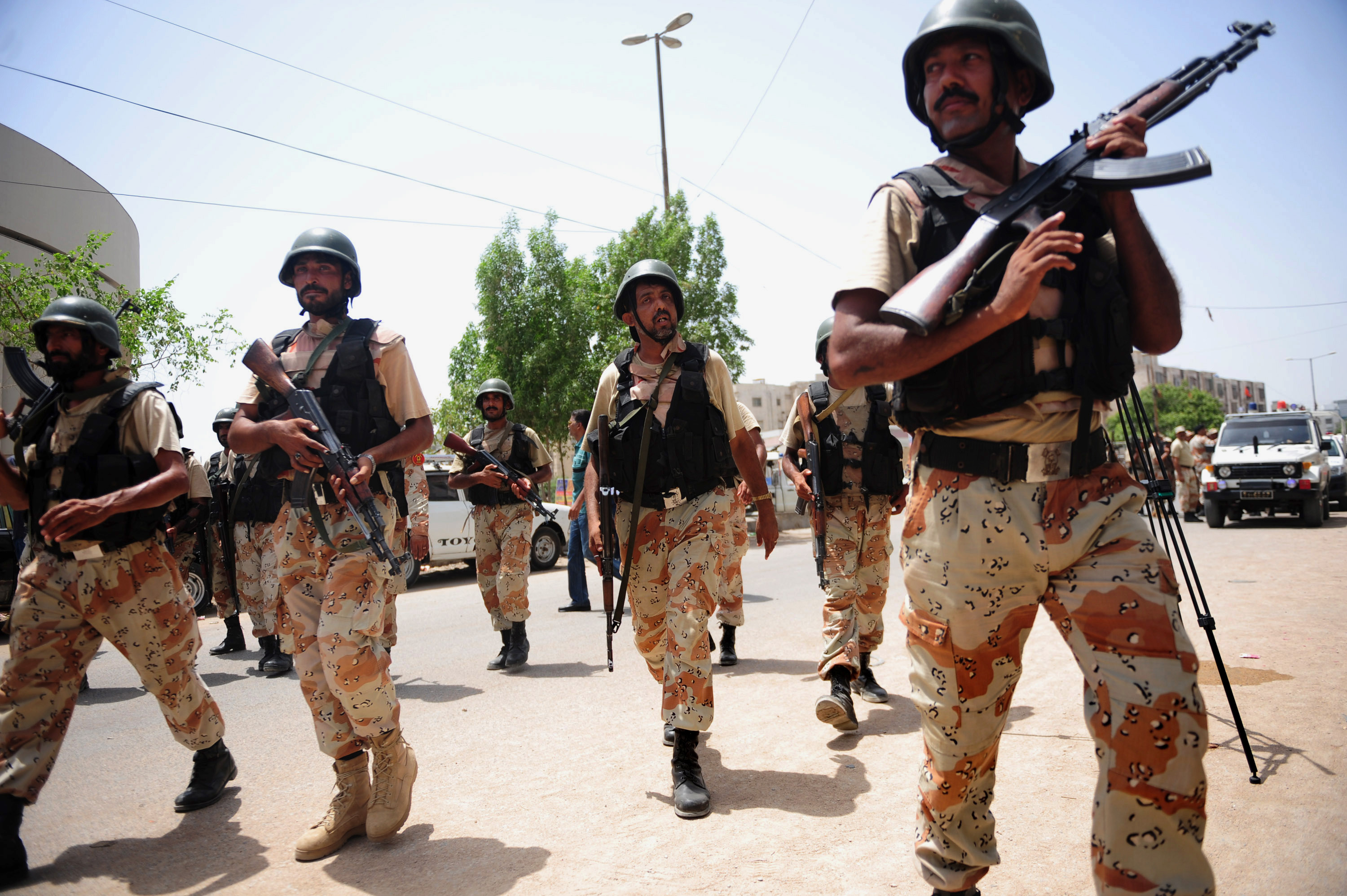 Pakistan rangers take part in a search operation after the firing incident near Karachi airport in Karachi on June 10, 2014. The second attack on Pakistan's Karachi airport in as many days ended without casualties, officials said, but with the escape of the two gunmen involved. AFP PHOTO/Rizwan TABASSUM